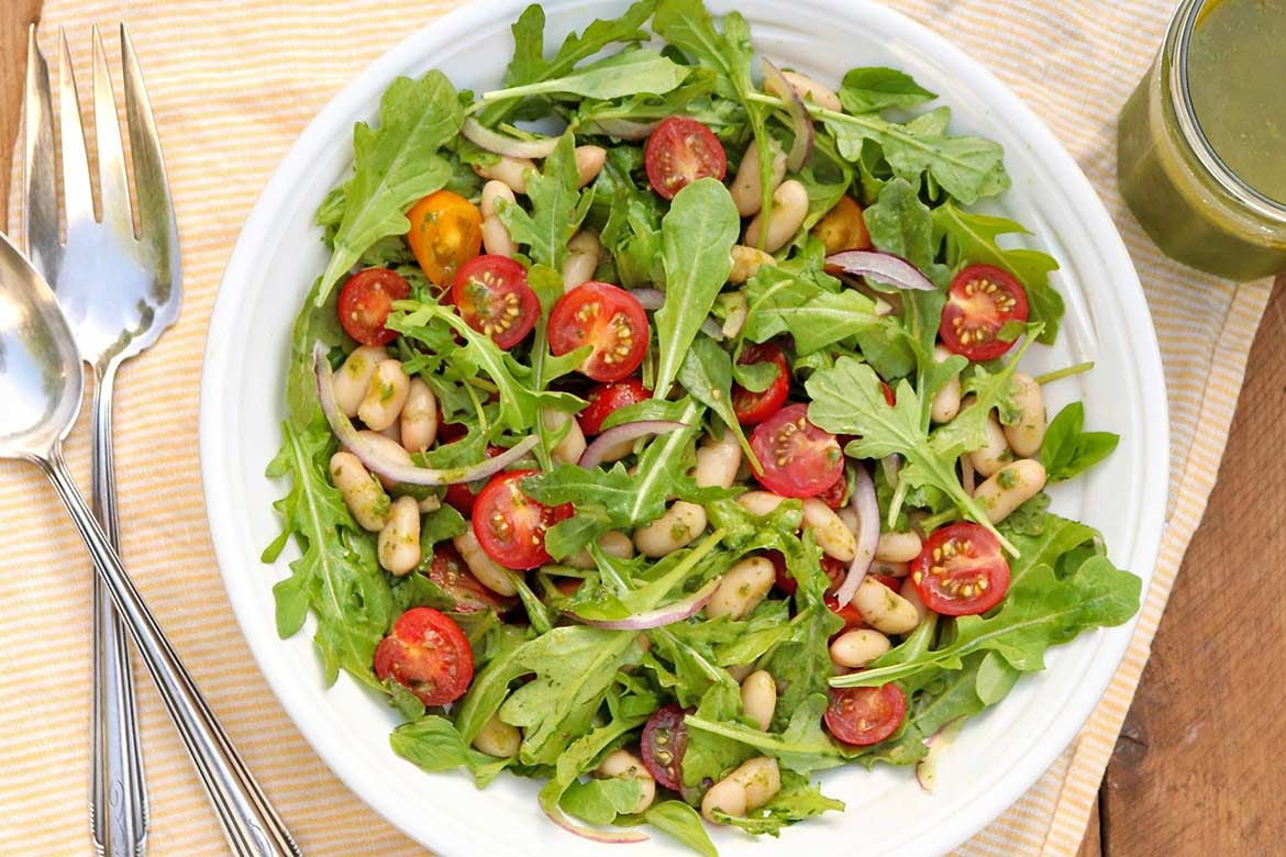 Tomato & White Bean Salad with Basil Vinaigrette —healthy, endlessly adaptable, and can be made in a flash with the easybasil vinaigretterecipe or your favorite pesto.