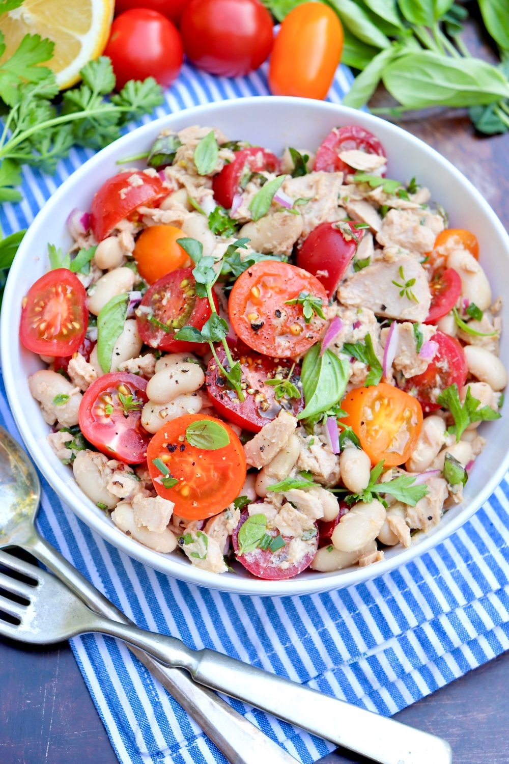 Tuna, Tomato & White Bean Salad-Pantry staples meet sweet tomatoes and ahandful of fresh herbs in this protein-rich, flavor-packed salad. Enjoy it as an easy lunch or pair with an ear of corn, piece of cornbread or a crusty roll for a light but filling dinner. (Leftovers taste great, too!)