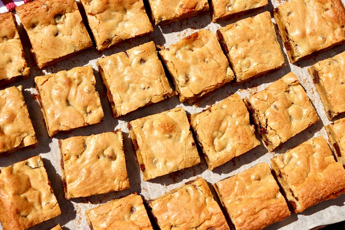 Congo Bars = the ultimate blondie! Perfectly chewy and so much easier to make than a batch of cookies, this foolproof recipe is a childhood favorite that has stood the test of time.