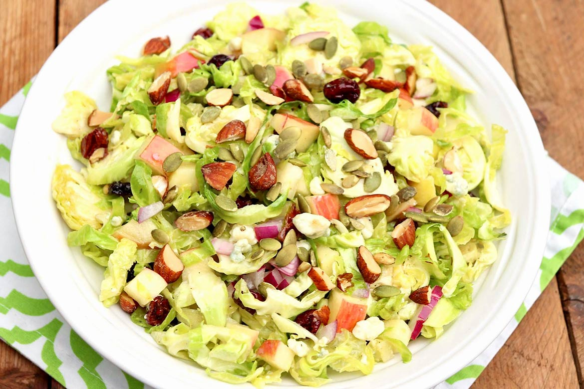 FAVORITE BRUSSELS SPROUTS SALAD - A go-to salad for busy nights, parties, potlucks and 100% worthy of a holiday table. This super-satisfying salad can be made in advance and you'll want to use the dressing over and over again.