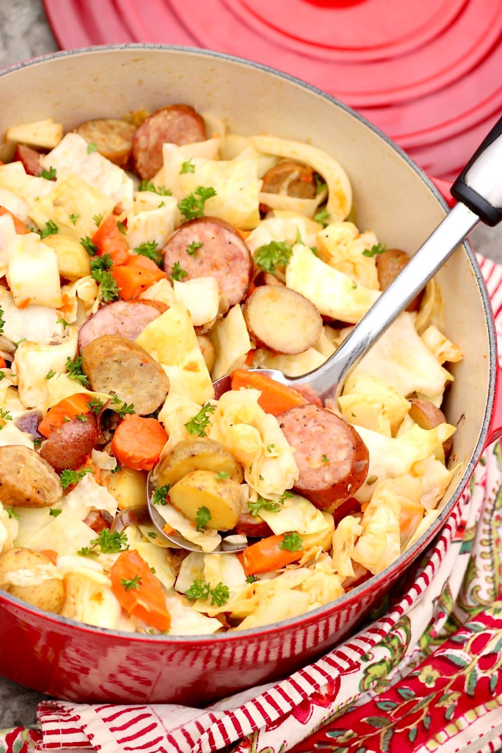 Smoky sausage, creamy potatoes, sweet cabbage and carrots are simmered in a simply seasoned broth for a one-pot meal that's deliciously easy and wholesomely satisfying.