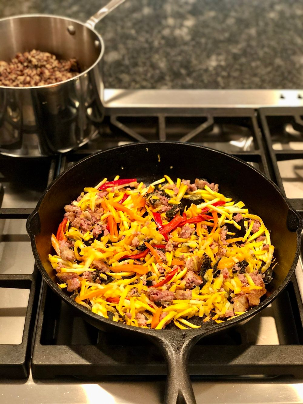 The addition of two flavorful proteins to a hearty dose of colorful vegetables makes this easy, one-pan meal a family favorite in our house. The recipe's inherent flexibility makes it ideal for using what you have on hand.