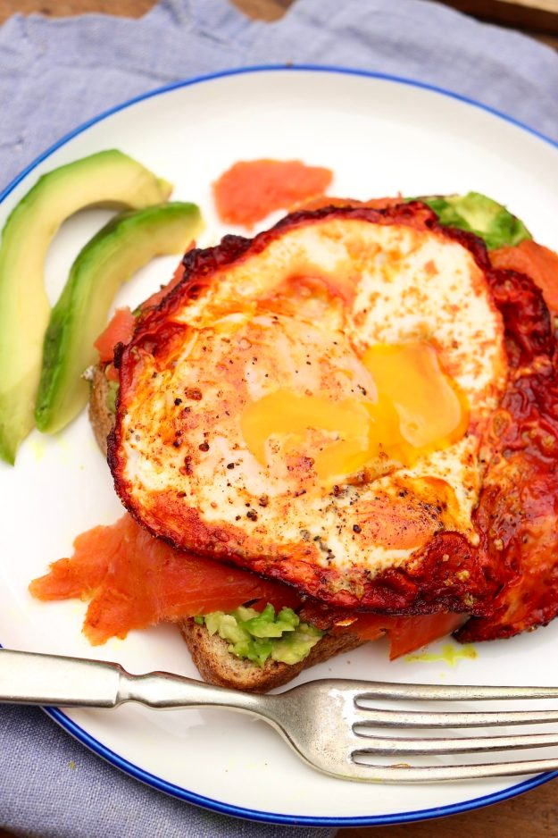 A crispy, turmeric-infused egg and a layer of Omega-3 rich salmon take the beloved avocado toast to soaring new heights!