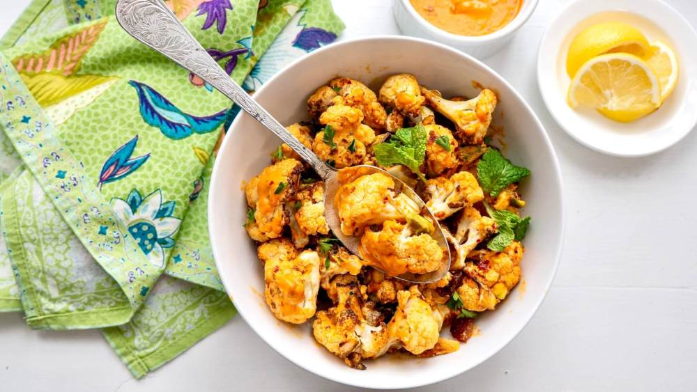 Simply roasted cauliflower is elevated to something special thanks to a versatile sauce that might just become a new favorite. The base recipe is perfect as a side dish, and a few pantry staples will transform it into a filling entree.