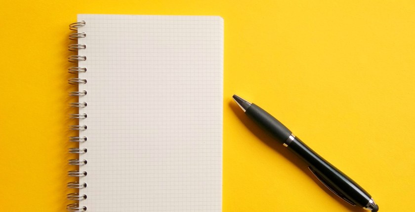 yellow image with pen and notepad