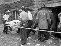 Removal of the girls' bodies from the rubble.