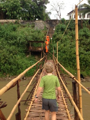 crossing the bamboo bridge into town