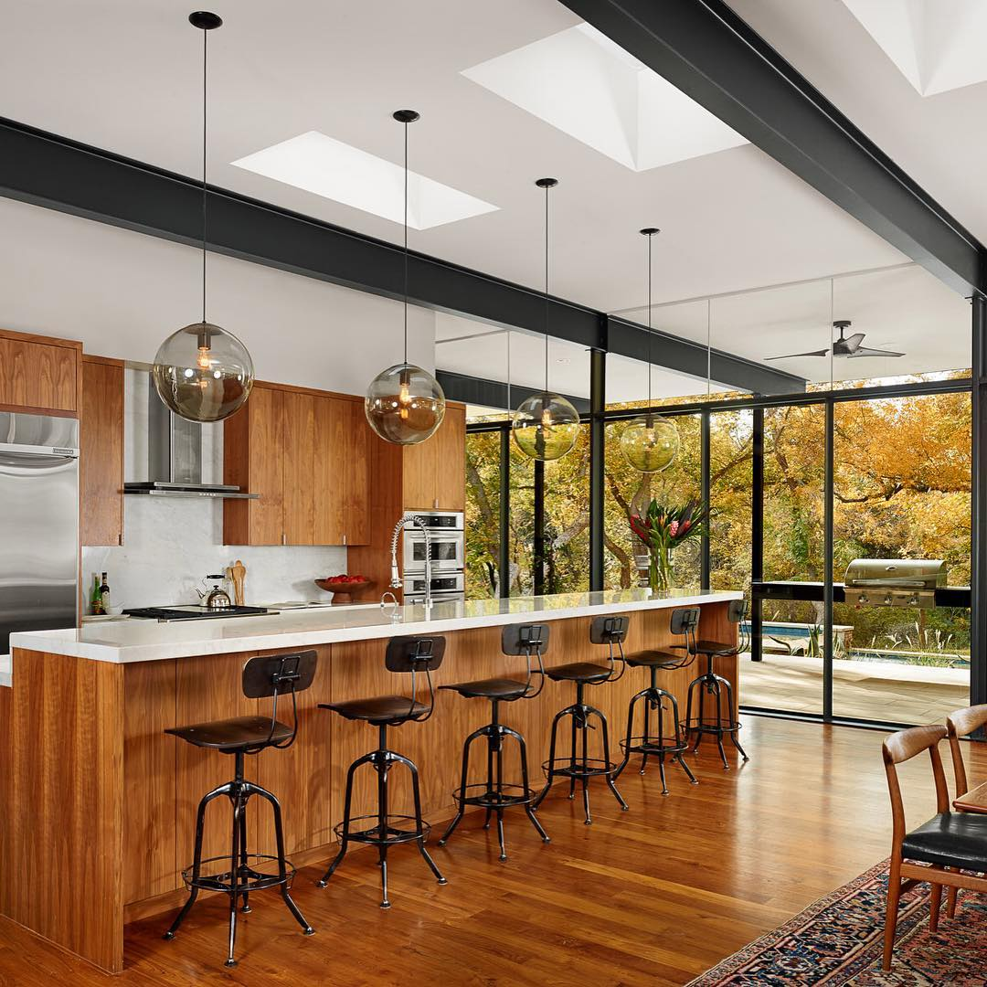 Now that's a kitchen bar to hang out!  Precision by @foursquarebuilders