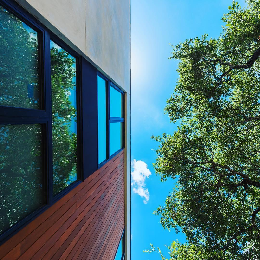 LaHabra smooth stucco, Garapa hardwood siding, Western windows built by @foursquarebuilders photo by @redpantsstudio designed by @aparallel