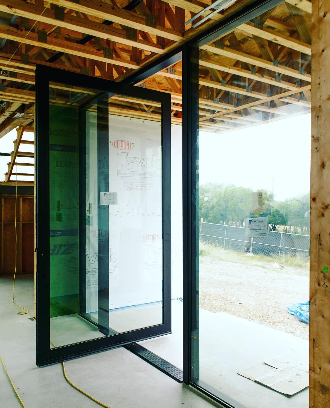 Fleetwood pivot door ready! Designed by @dc_architecture Built by @foursquarebuilders Photo by @redpantsstudio