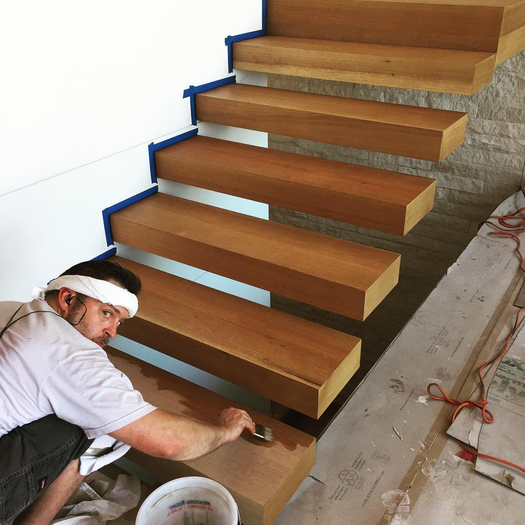 Final finishing touches on our @hewnatx white oak built stair treads supported by steel stringers built by @drophousedesign Home built by @foursquarebuilders