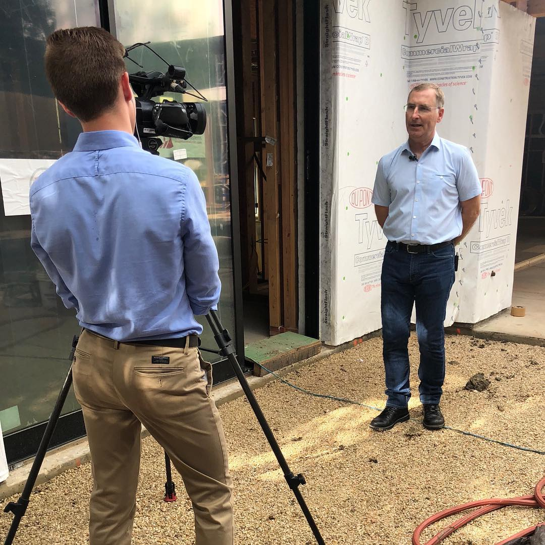 On location being interviewed by KXAN. Topic: How has all the rain impacted construction in Austin, Texas.