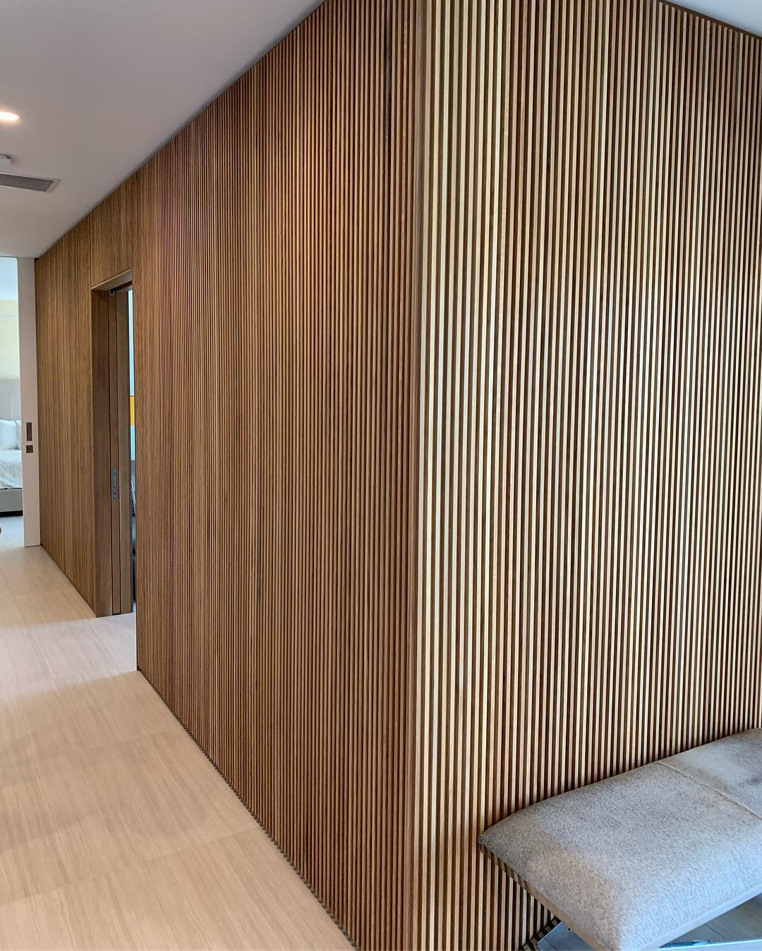 Simple yet complex white oak slat wall details. Designed by @dc_architecture Built by @foursquarebuilders and @flitchatx