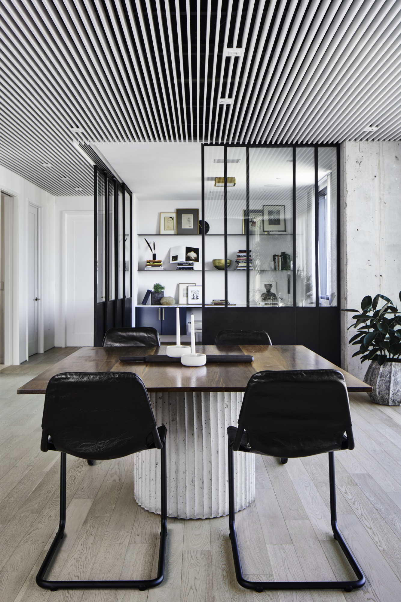 Slatted suspended ceiling creates openness throughout.