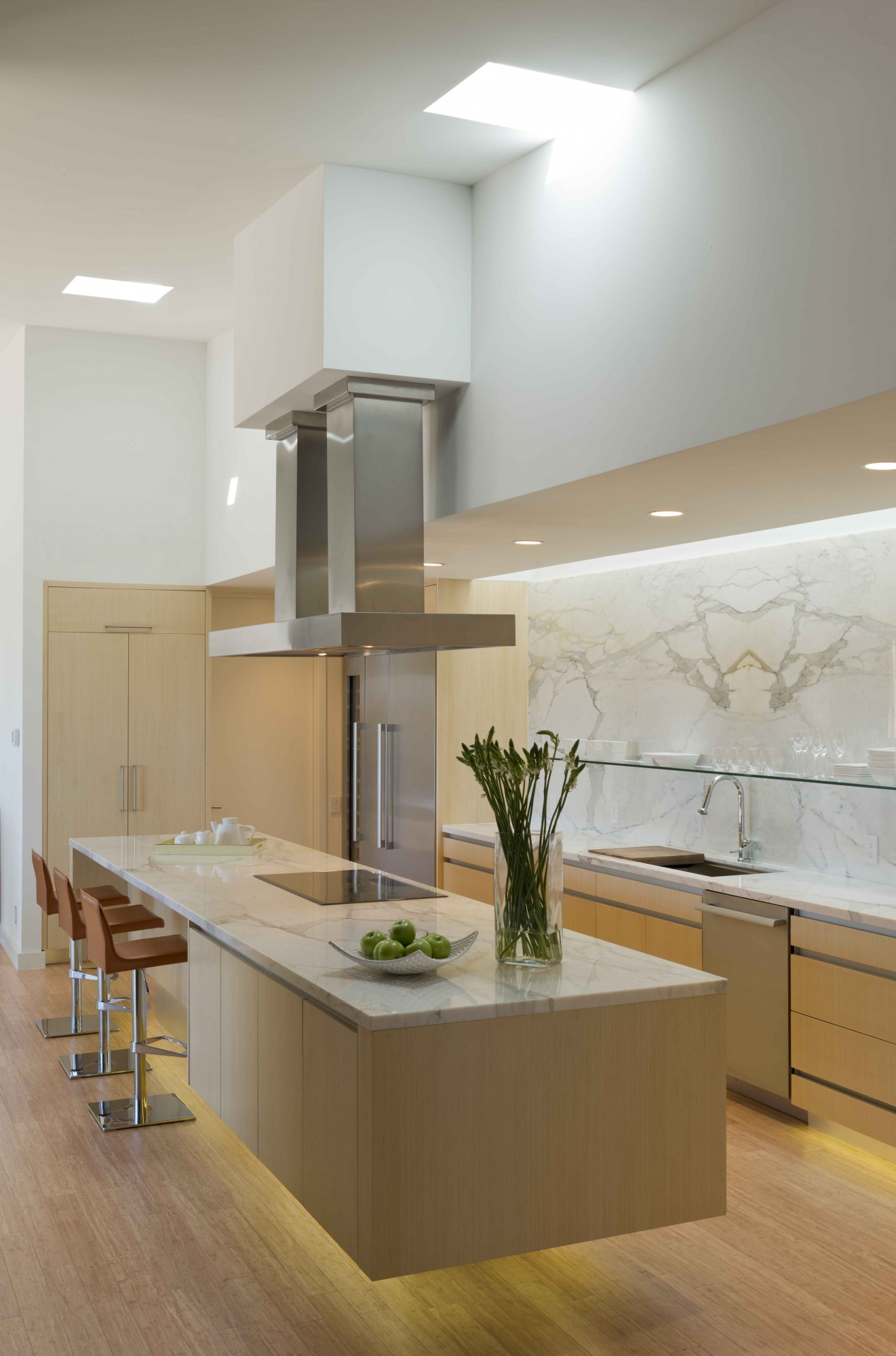 The appearance of levitation is experienced within the kitchen cabinetry.