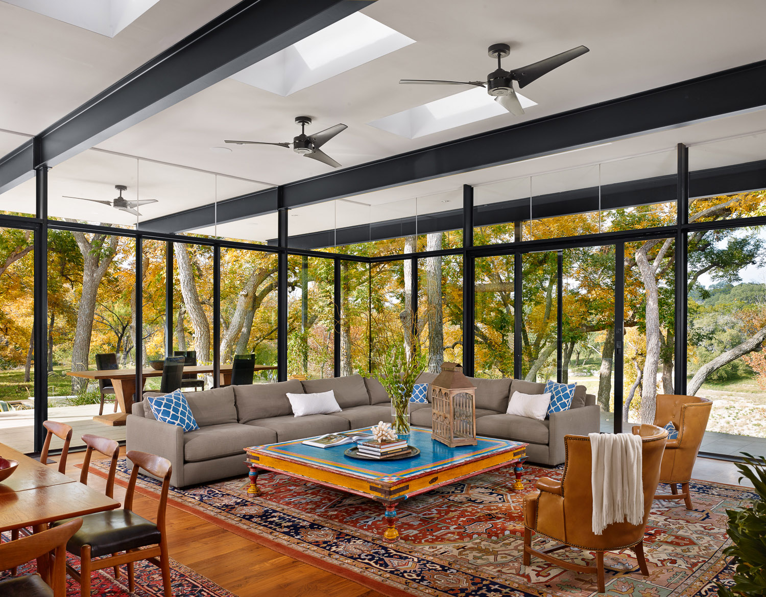 Outdoor living from within these steel and glass walls.