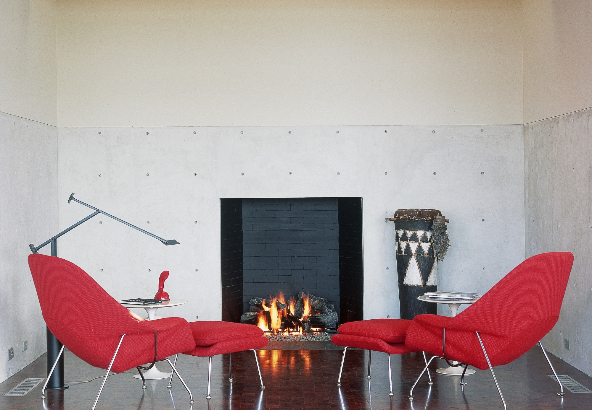 Sarrinen Womb Chairs respond to the warmth of the fireplace.