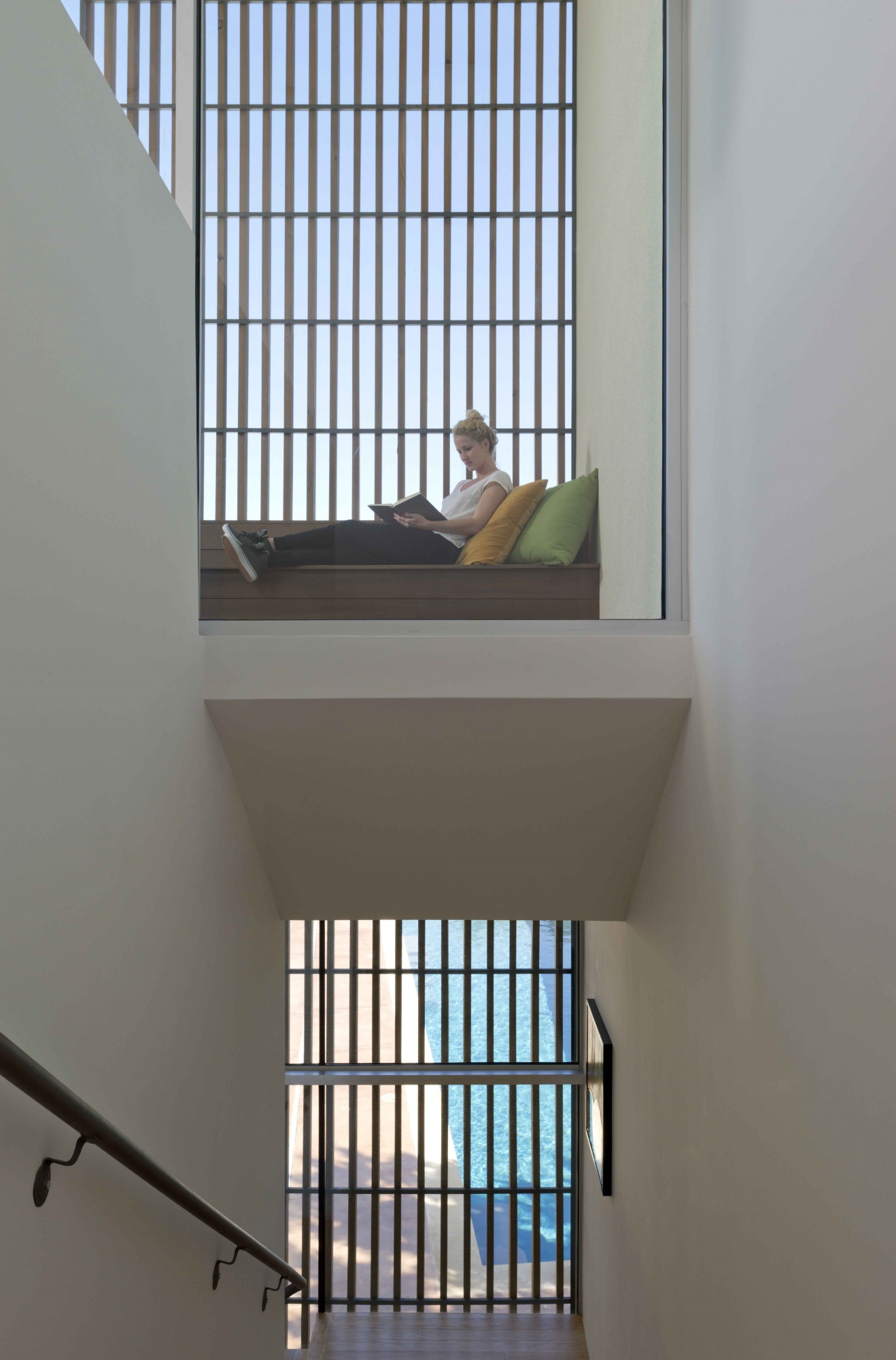 Sheltered balcony provides for an outdoor experience that overlooks the pool and the city beyond.