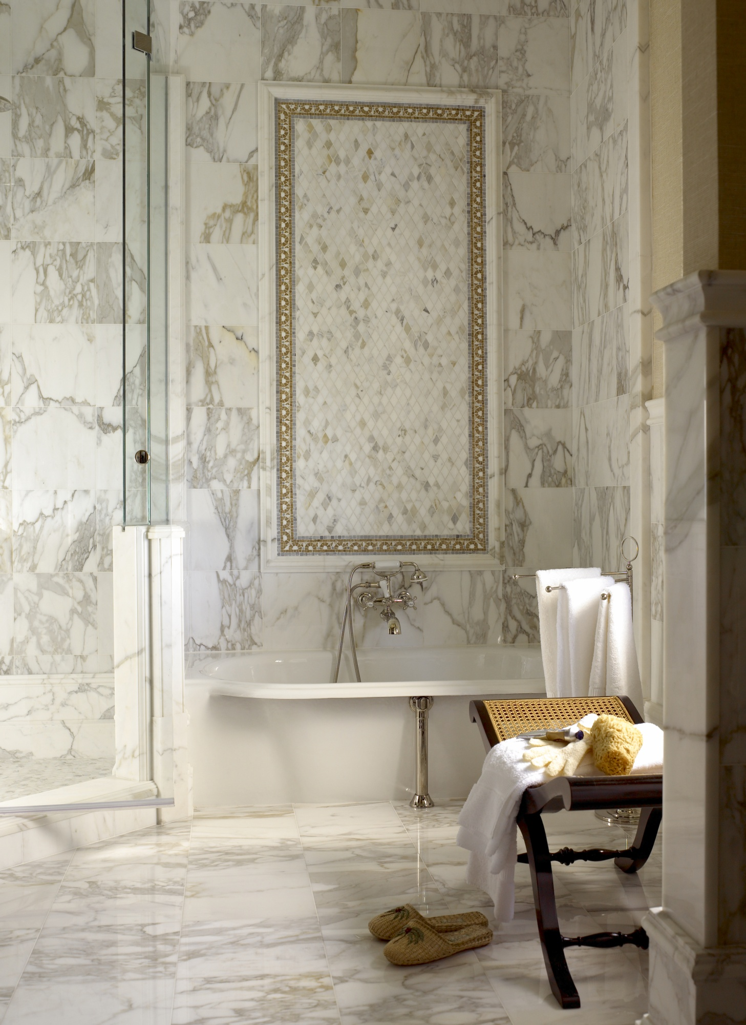 Marble mosaic tiles and nickel finishes within this guest bathroom.