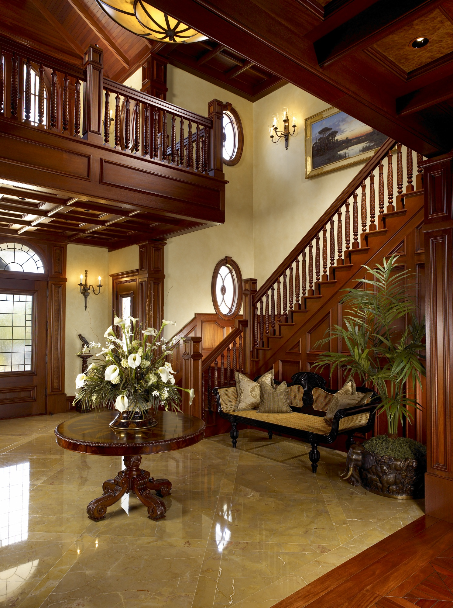 Hand carved mahogany banisters provide beauty to this entry stair.