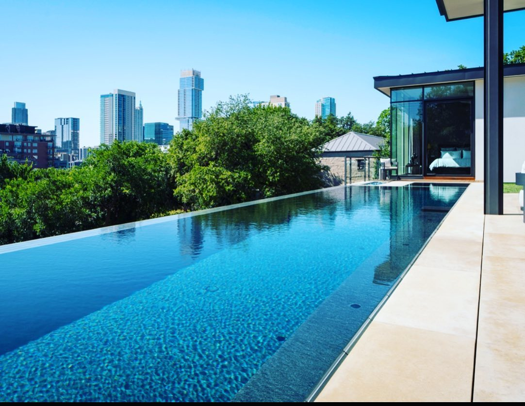 Our clients could be sheltered in place pretty much anywhere they wanted. Their first choice was to be in their new home overlooking Austin's downtown skyline. Built by @foursquarebuilders Designed by @laruearchitects Pool by @austinwaterdesigns Interiors by @lovecounty