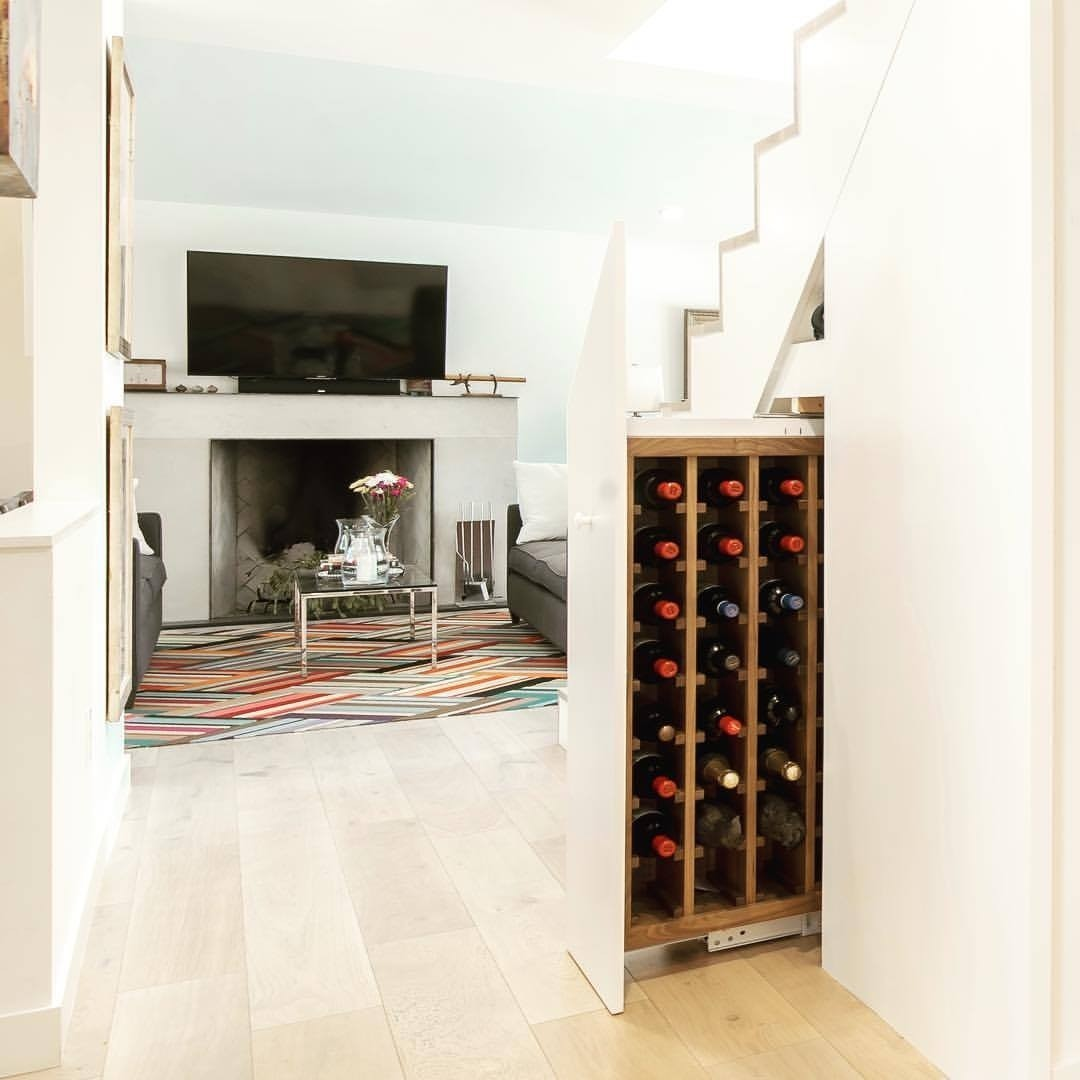 Custom Walnut storage for 64 bottles of wine   That's 1.2 bottles per week for 2020.  Great use of under stair space.   Designed & Built by @foursquarebuilders  Photo by @redpantsstudio