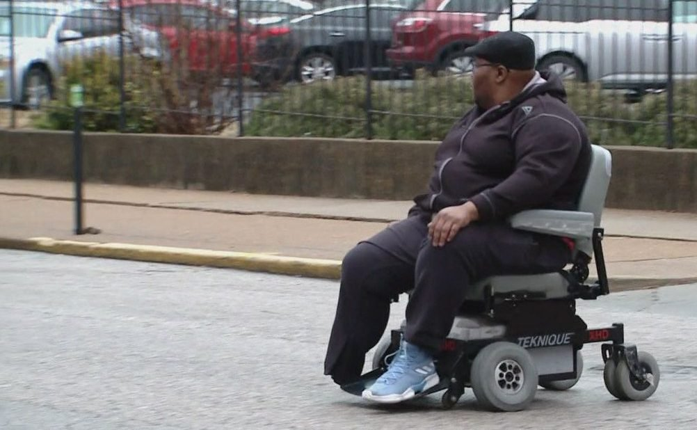 Picture of man in motorized wheelchair