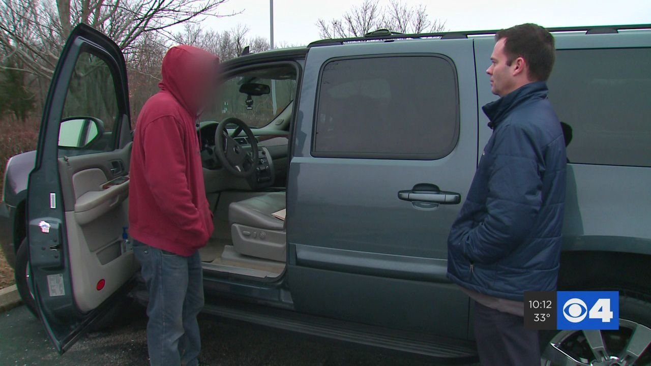 Man standing next to vehicle