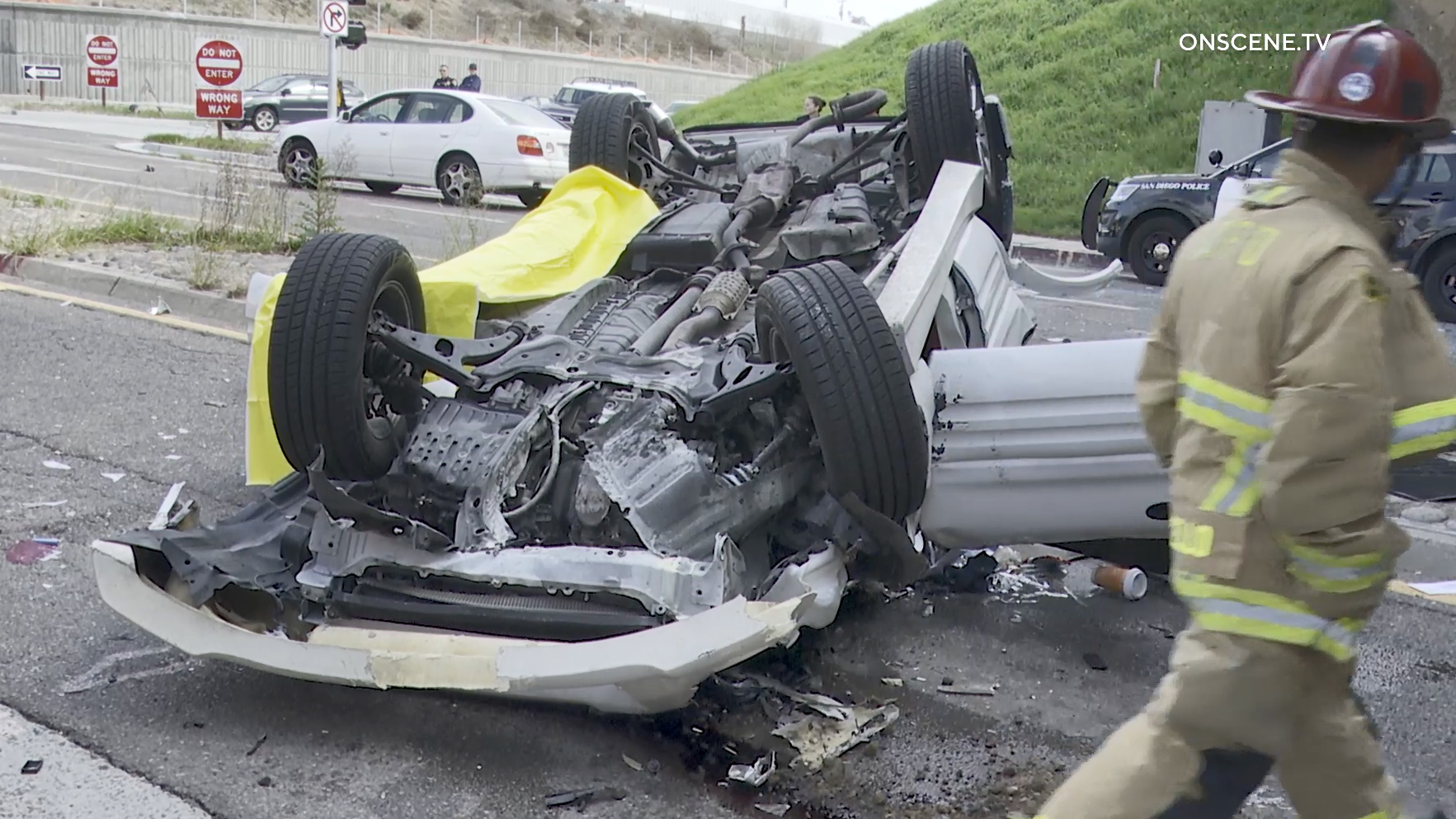 A driver was killed when this Jeep went off a freeway overpass in Pacific Beach and landed on its roof. (Video: Onscene.tv)