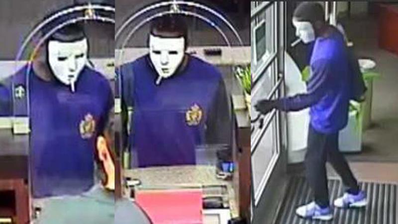 A masked man wielding an aluminum baseball bat robbed a Park West-area bank Tuesday.