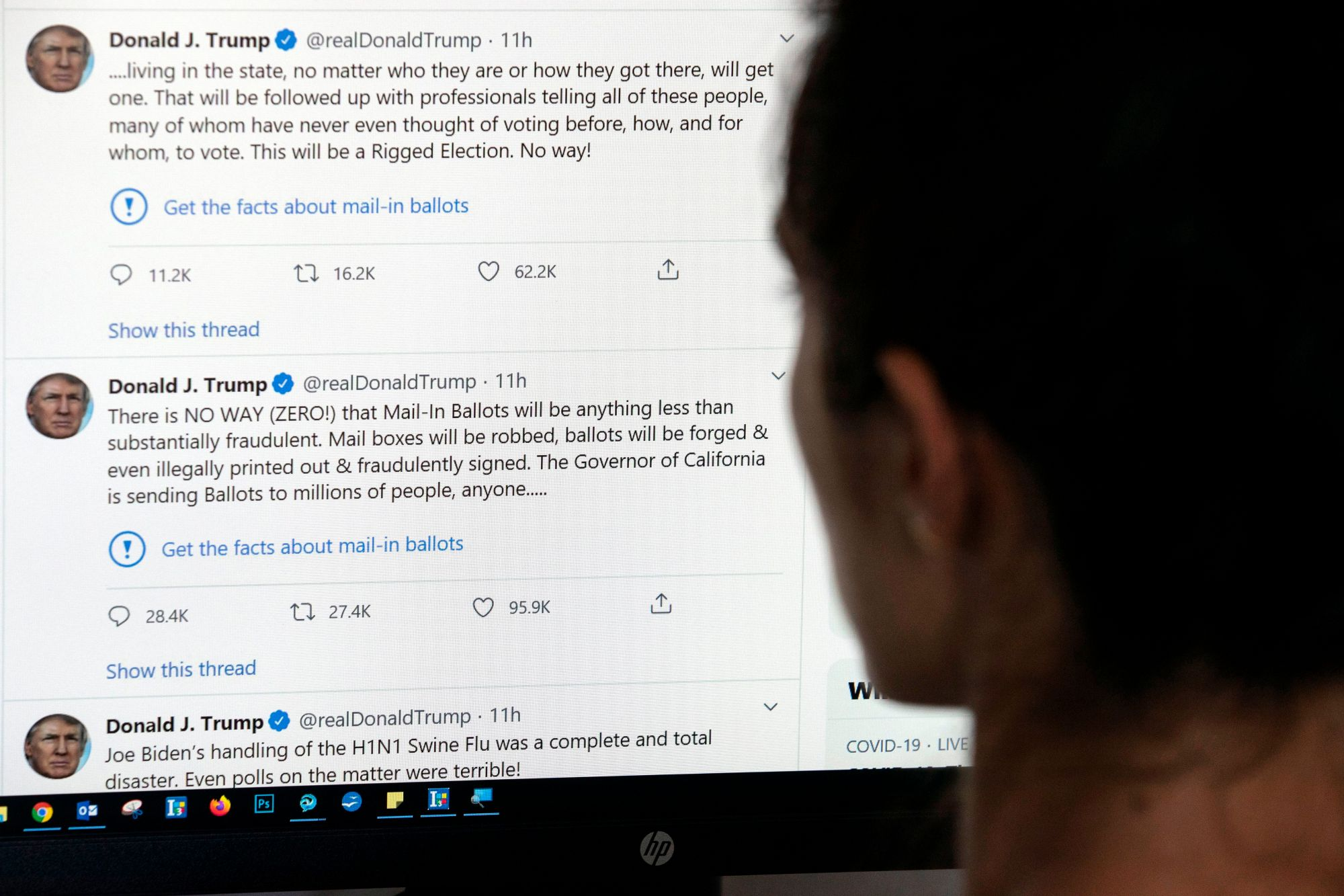 This illustration photo shows an editor in Los Angeles looking at the official Twitter account of US President Donald Trump