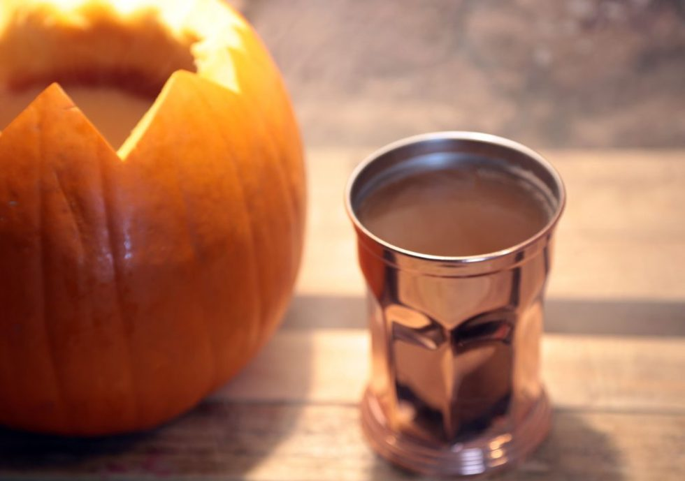 pumpkin spice punch served from a pumpkin for your halloween party