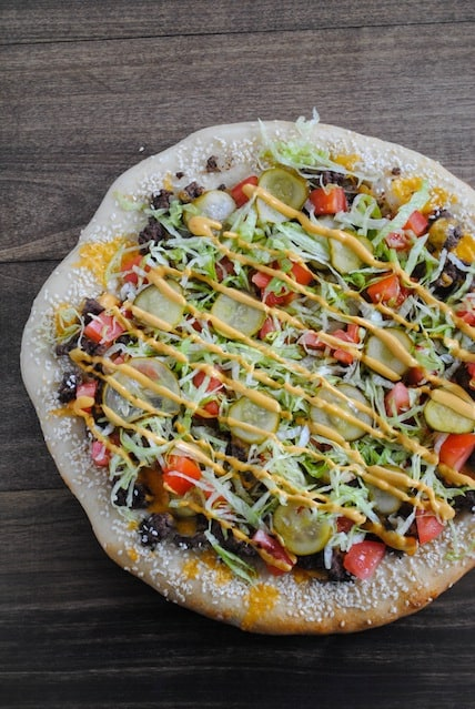Cheeseburger Pizza - Ground beef, special sauce, lettuce, cheese, pickles, onions...on a sesame seed crust.   foxeslovelemons.com