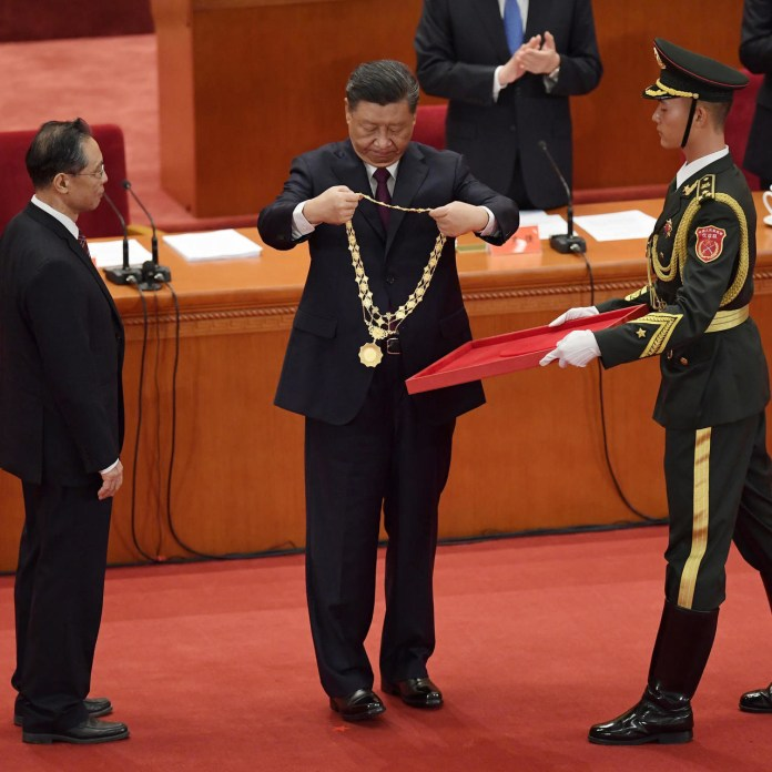 Chinese President Xi Jinping awarded four medical professionals as China won the historic battle