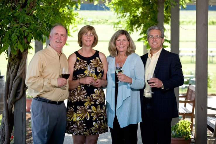 Fox Run owners standing by the vineyard