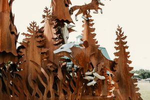 Upclose shot of the foxes and trees on Fox Run's gate