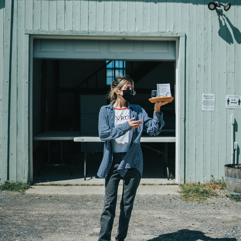 Fox Run employee standing in front of The Wine Barn