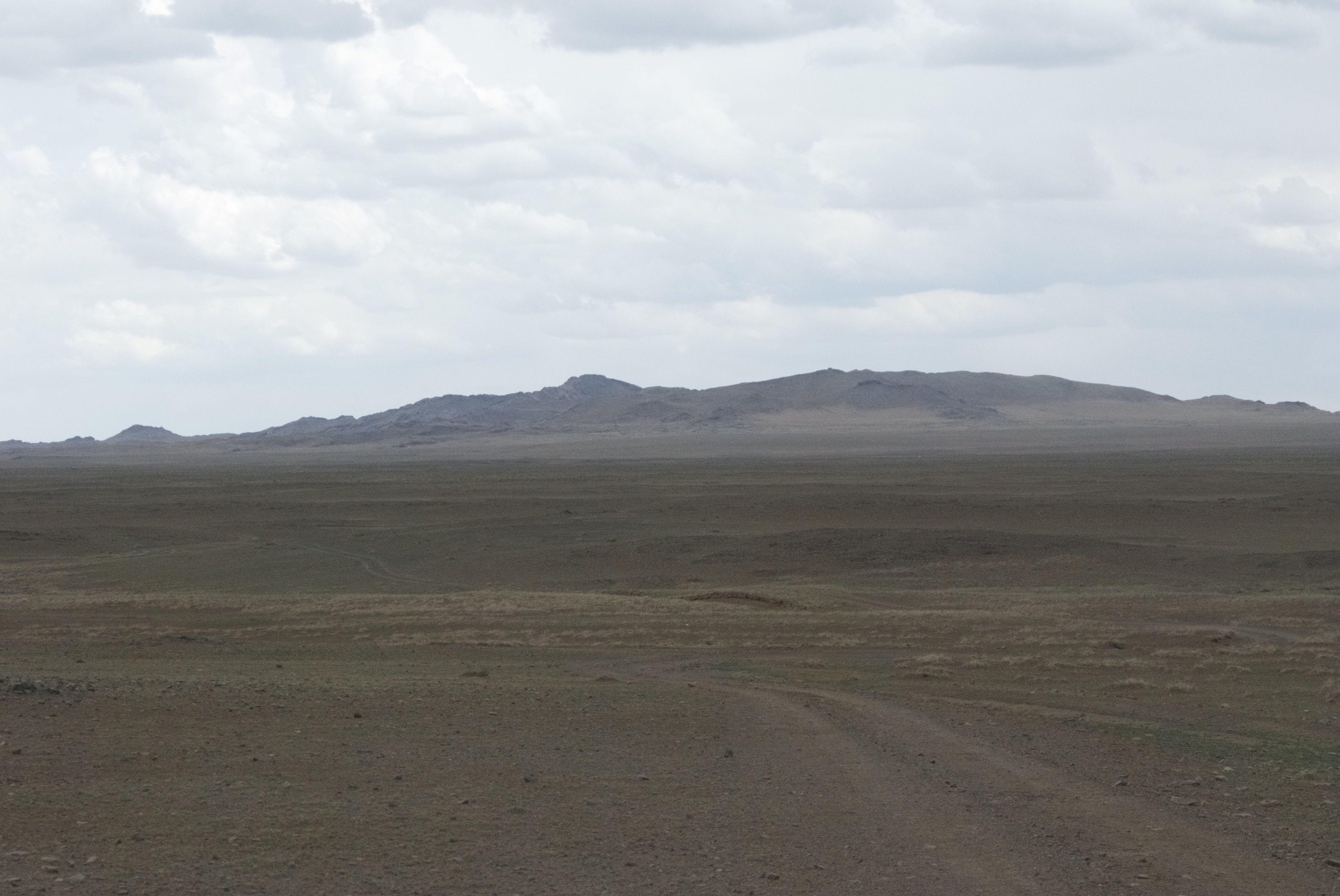 Baga Gazriin Chuluu rises out of the steppe