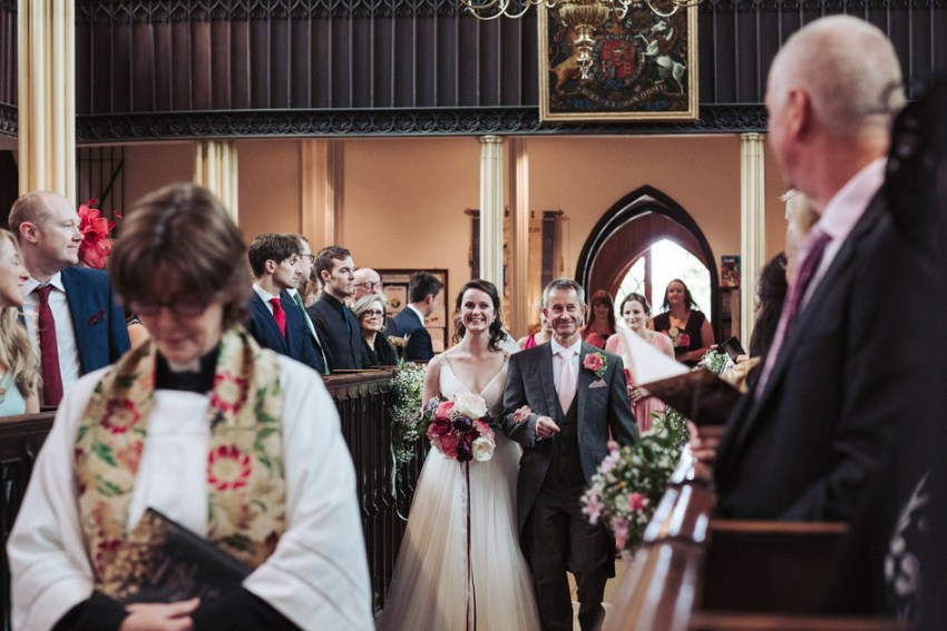 Bride and father walking down the isle | Tetbury wedding
