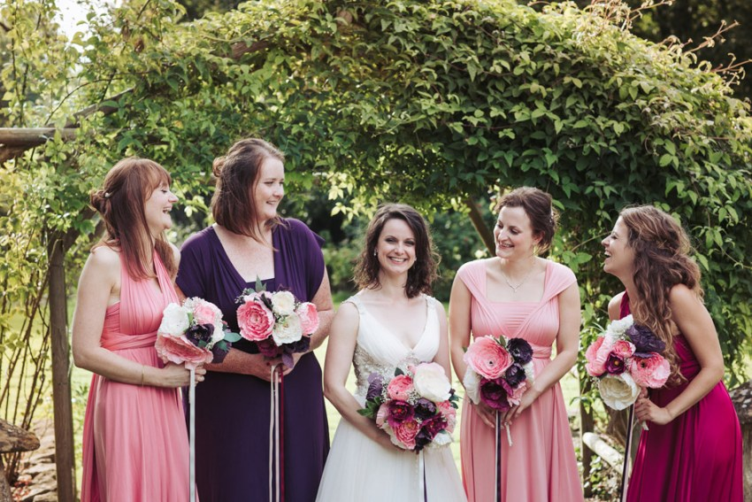 Bridal party with handmade paper bouquets in pink white and purple
