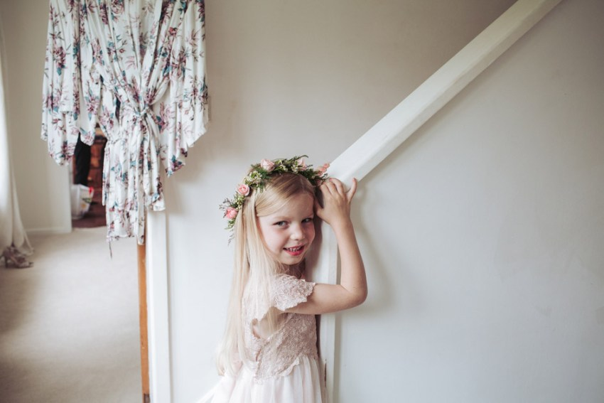 Flower girl in flower crown of pink roses
