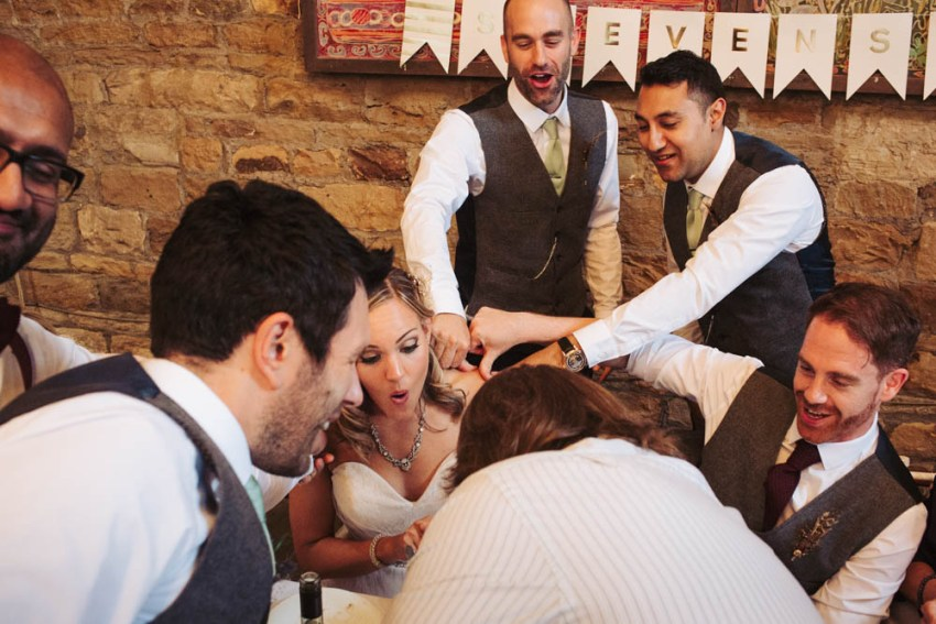 Groomsmen play stag games 'thumbs' at wedding | Oakwell Hall barn wedding Leeds photographer