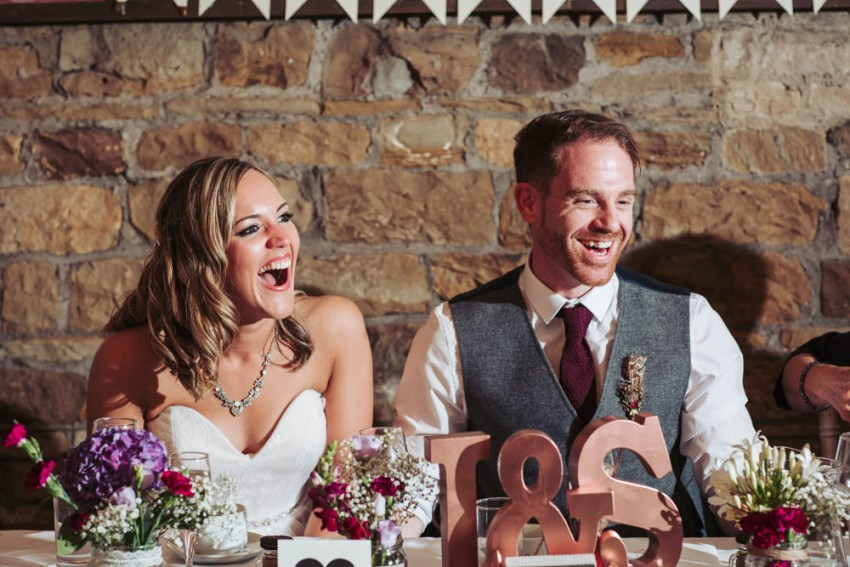 Bride and groom laugh during speeches | Oakwell Hall wedding photography Yorkshire, Leeds, York
