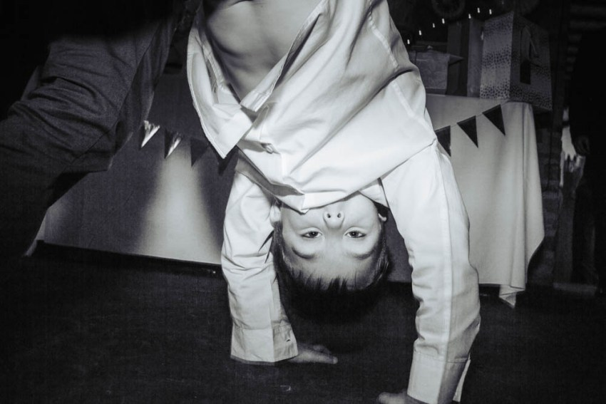 Upside down boy on dance floor