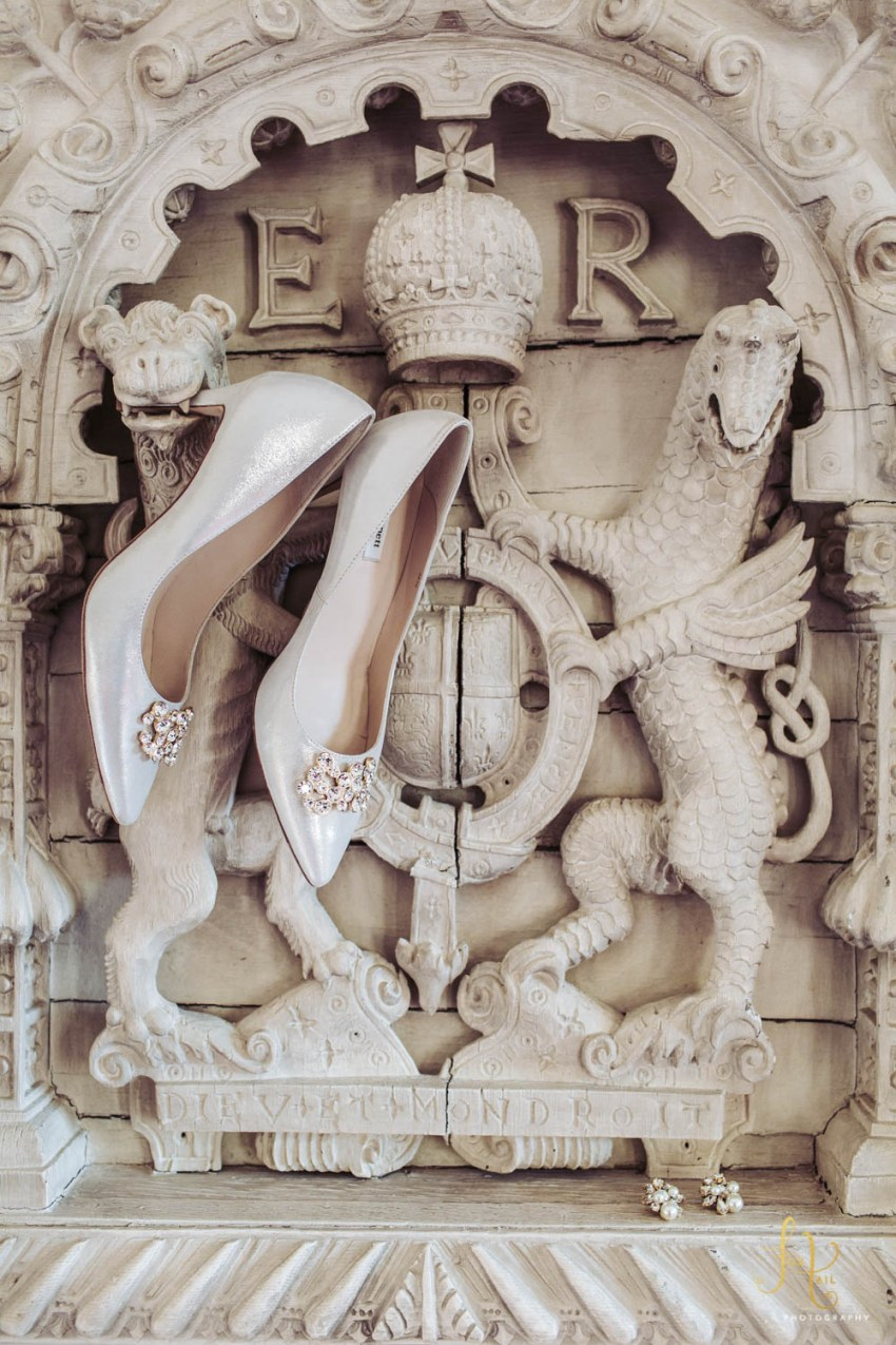 Brides shoes in mouth of Lion fireplace carving | Cliveden House