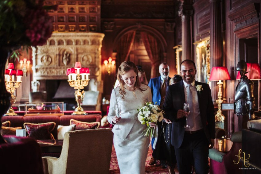 Bride and groom enjoy Cliveden House wedding reception in the great hall   Leeds wedding photographer, Yorkshire