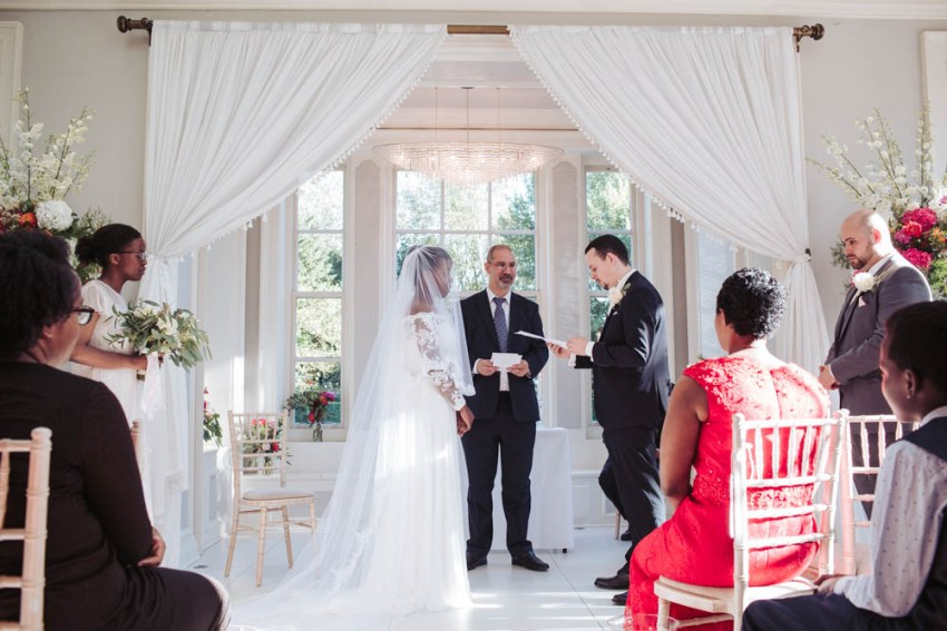 Groom reads vows to bride during Saltmarshe Hall wedding ceremony | Documentary wedding photography