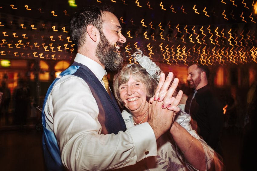 Groom dances with the mother of the bride to the ceilidh band.