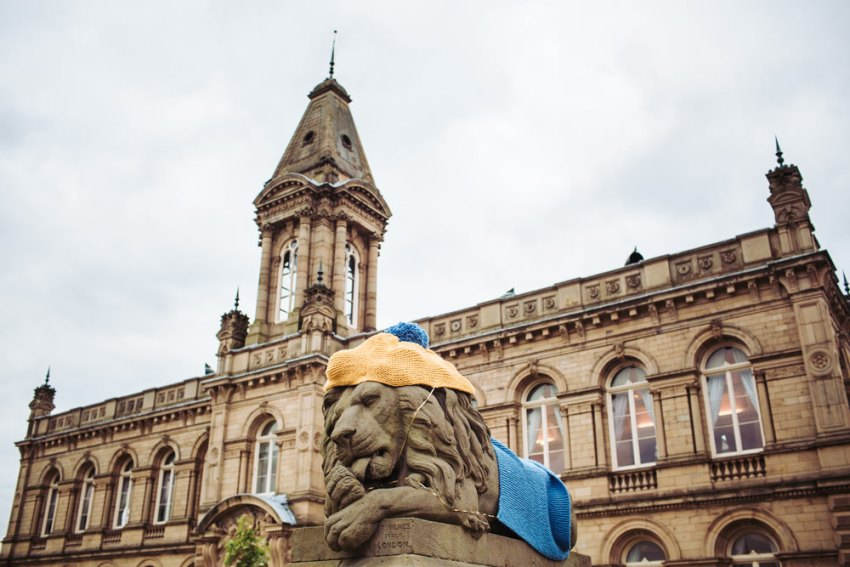 Victoria Hall wedding photographer. Lion dressing in knitted hat and cape for the Tour De Yorkshire.