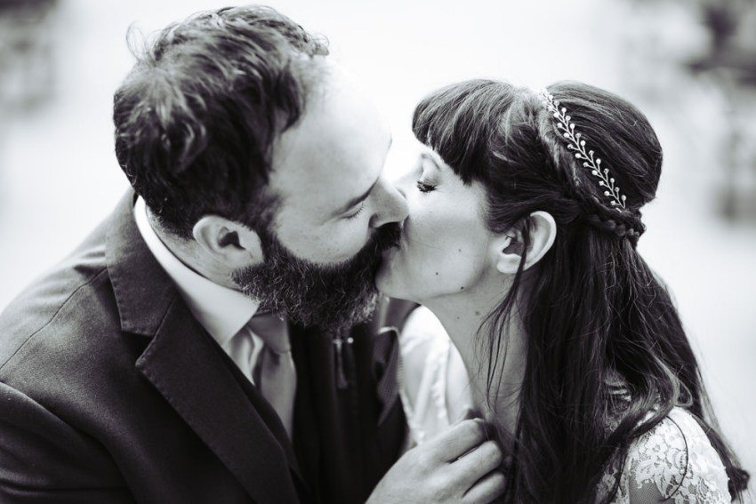 Victoria Hall wedding photographer Saltaire Yorkshire. Bride and groom kiss.
